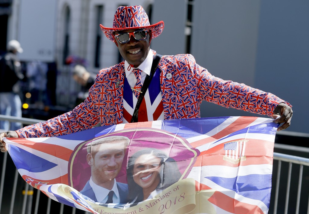 A royal fan waves a flag in Windsor, England, Thursday, May 17, 2018. Britain's Prince Harry and Meghan Markle will marry in Windsor on Saturday May 1