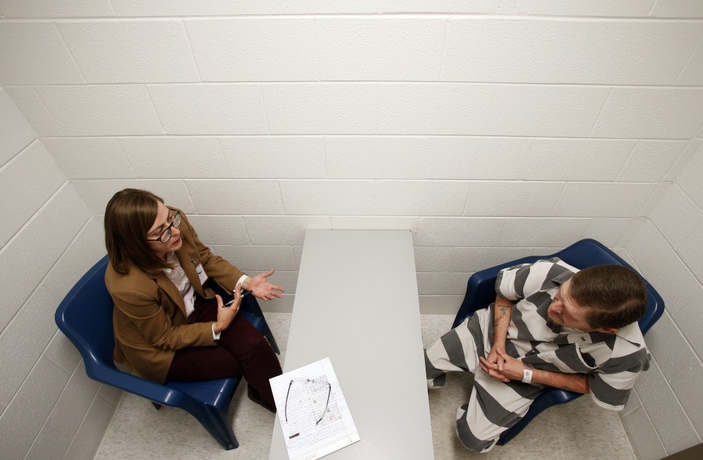 In this Tuesday, May 1, 2018 photo, attorney Mary Frances Charlton, left, talks with inmate Richard Walls during an interview at the Richmond City Jai