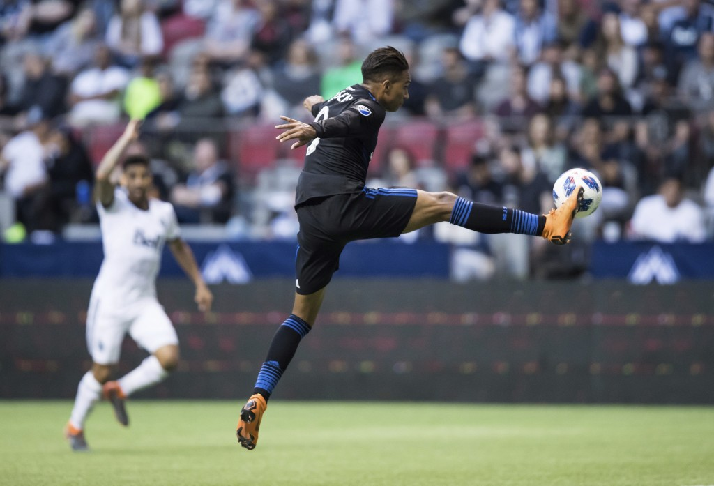 San Jose Earthquakes' Danny Hoesen knocks the ball out of the air with his foot and scores a goal against the Vancouver Whitecaps during the first hal
