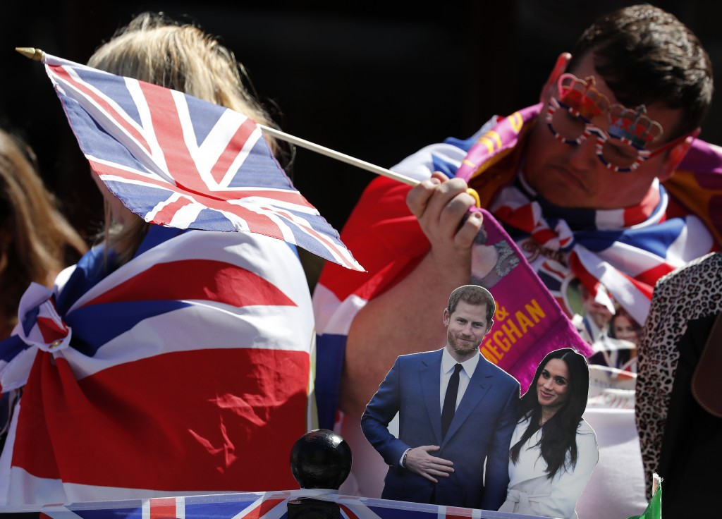 Fans wait to watch a rehearsal of the wedding in Windsor, England, Thursday May 17, 2018. Preparations are being made in the town ahead of the wedding