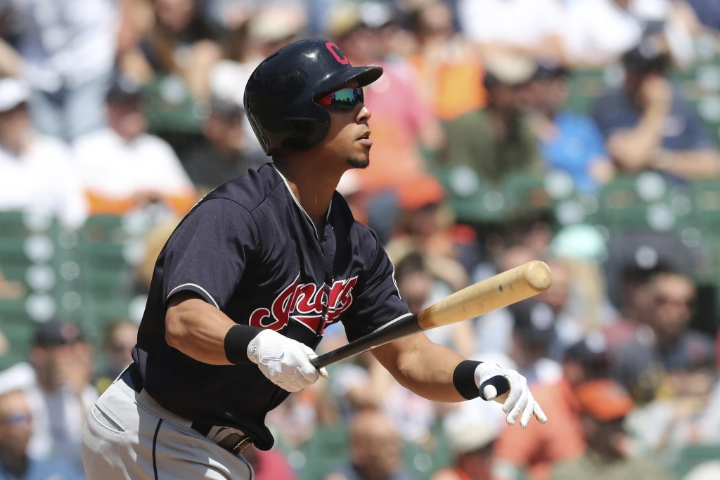 Cleveland Indians' Michael Brantley watches his solo home run clear the right field wall during the fifth inning of a baseball game against the Detroi