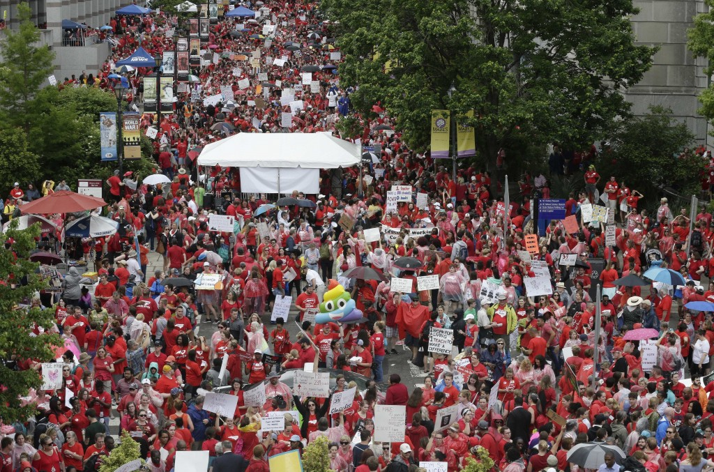 Educators fill Bicentennial Plaza during a teachers rally at the General Assembly in Raleigh, N.C., Wednesday, May 16, 2018. Thousands of teachers ral