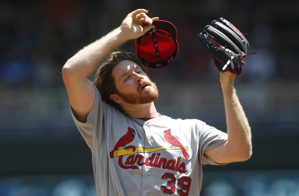 St. Louis Cardinals' pitcher Miles Mikolas takes a moment following a mound visit after Minnesota Twins' Max Kepler drove in a run in the first inning...
