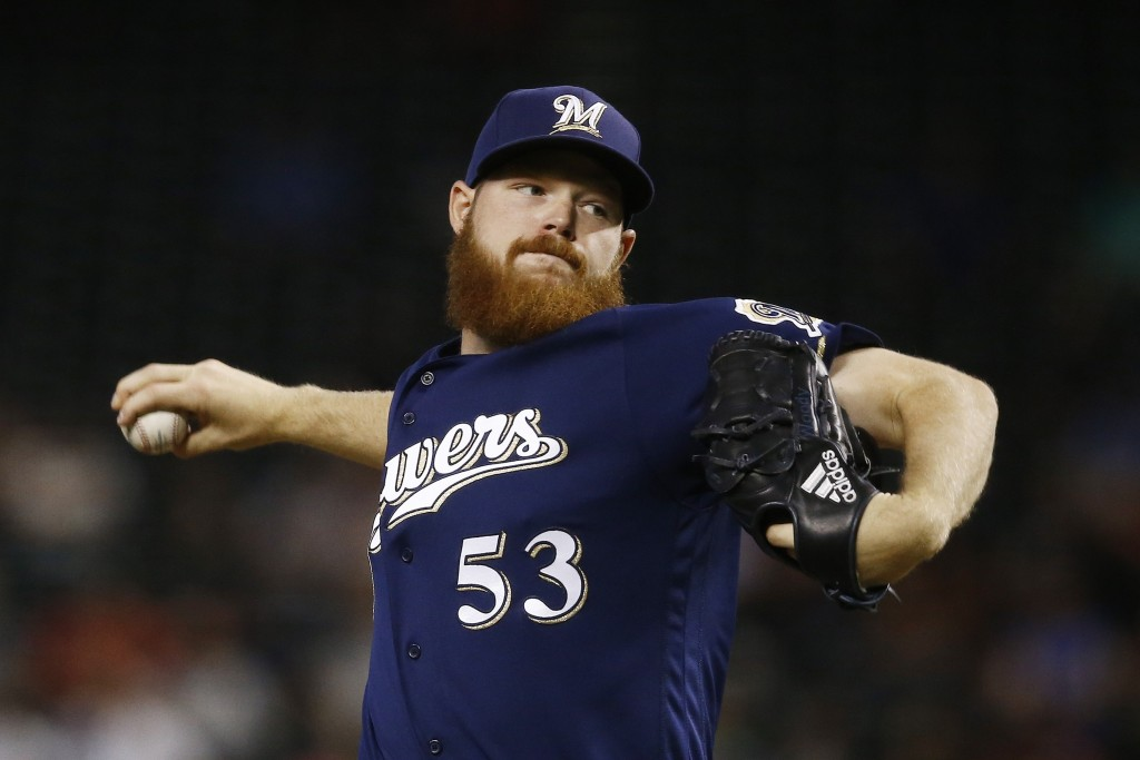 Milwaukee Brewers pitcher Brandon Woodruff throws against the Arizona Diamondbacks during the first inning of a baseball game Wednesday, May 16, 2018,