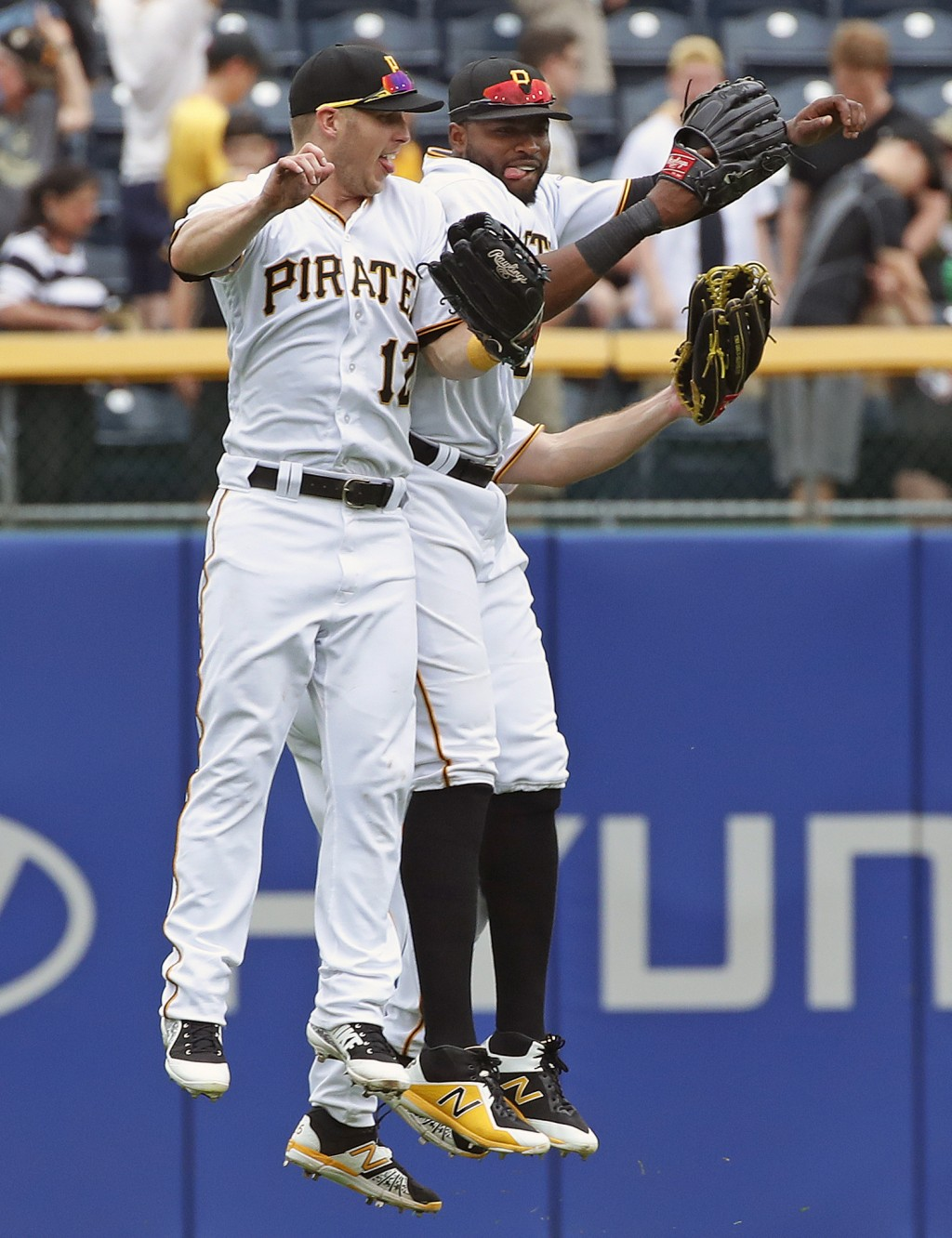 Pittsburgh Pirates outfielders Corey Dickerson (12), Gregory Polanco, right, and Adam Frazier, rear, celebrate after getting the final out of a baseba