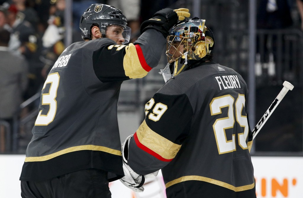 Vegas Golden Knights defenseman Brayden McNabb, left, celebrates with goaltender Marc-Andre Fleury after the team's 4-2 win against the Winnipeg Jets