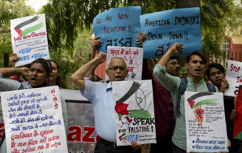 A small group of Indian protestors hold placards to condemn what they say is Israel's aggression against Palestinians and the U.S. decision to move it