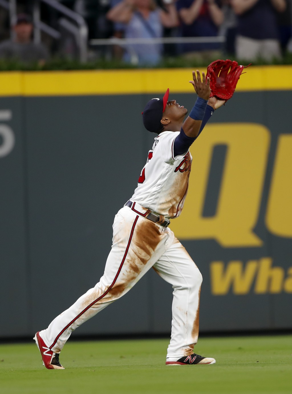 Atlanta Braves left fielder Ronald Acuna Jr. celebrates at the end of the team's baseball game against the Chicago Cubs on Wednesday, May 16, 2018, in