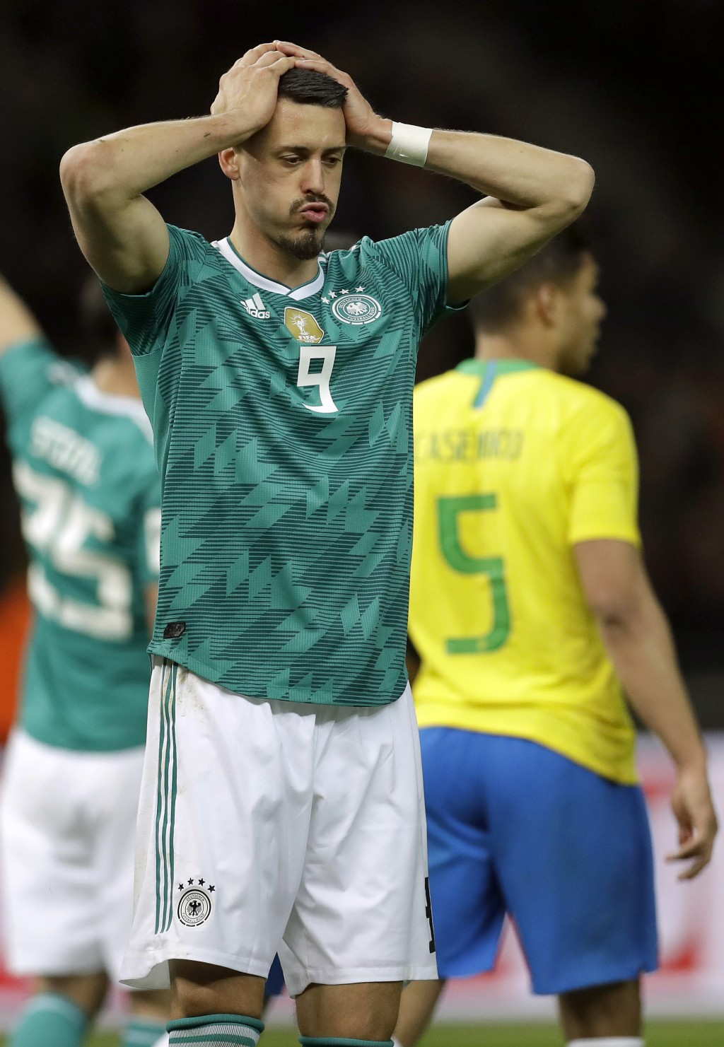 File -- In this Tuesday, March 27, 2018 photo Germany's Sandro Wagner reacts during the international friendly soccer match between Germany and Brazil
