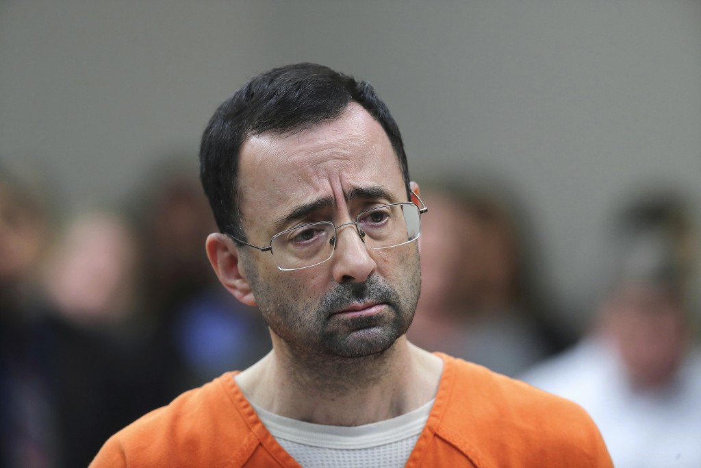 FILE - In this Nov. 22, 2017, file photo, Dr. Larry Nassar appears in court for a plea hearing in Lansing, Mich. Michigan State University has reached