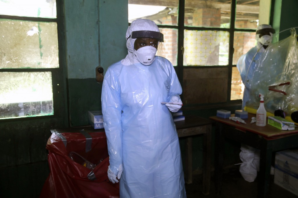 In this photo taken on Sunday, May 13, 2018, a health care worker wears virus protective gear at a treatment center in Bikoro Democratic Republic of C