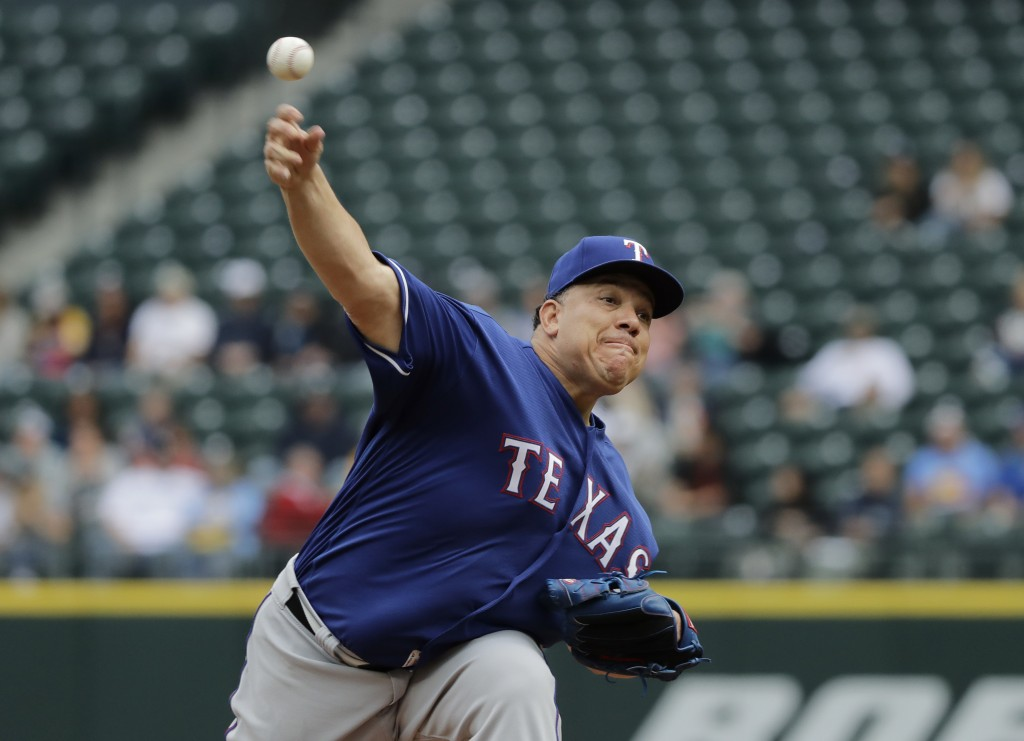 Texas Rangers starting pitcher Bartolo Colon throws against the Seattle Mariners during the first inning of a baseball game, Wednesday, May 16, 2018,