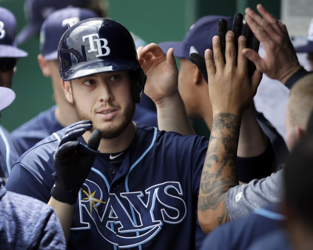 Tampa Bay Rays designated hitter C.J. Cron is congratulated by teammates after hitting a solo home run off Kansas City Royals starting pitcher Jason H