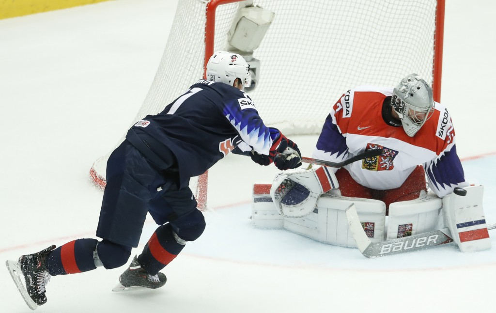 Czech Republic's Pavel Francouz, right, makes as ave against Dylan Larkin, left, of the United States during the Ice Hockey World Championships quarte