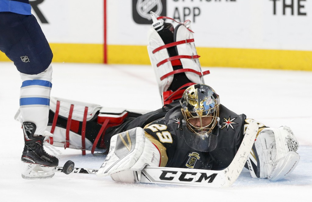 Vegas Golden Knights goaltender Marc-Andre Fleury makes a save against the Winnipeg Jets during the third period of Game 3 of the NHL hockey playoffs