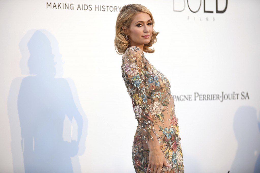 Socialite Paris Hilton poses for photographers upon arrival at the amfAR, Cinema Against AIDS, benefit at the Hotel du Cap-Eden-Roc, during the 71st i