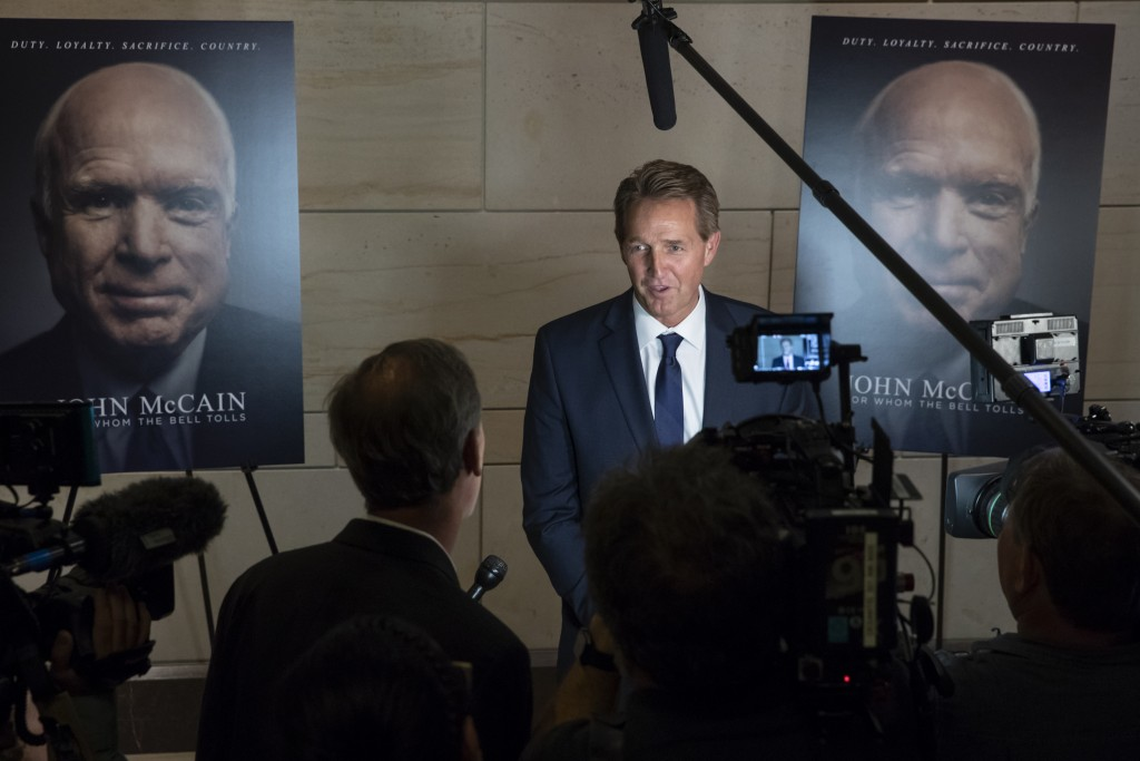 Sen. Jeff Flake, R-Ariz., speaks about Sen. John McCain, R-Ariz., at an event on Capitol Hill to debut a documentary film about McCain, in Washington,