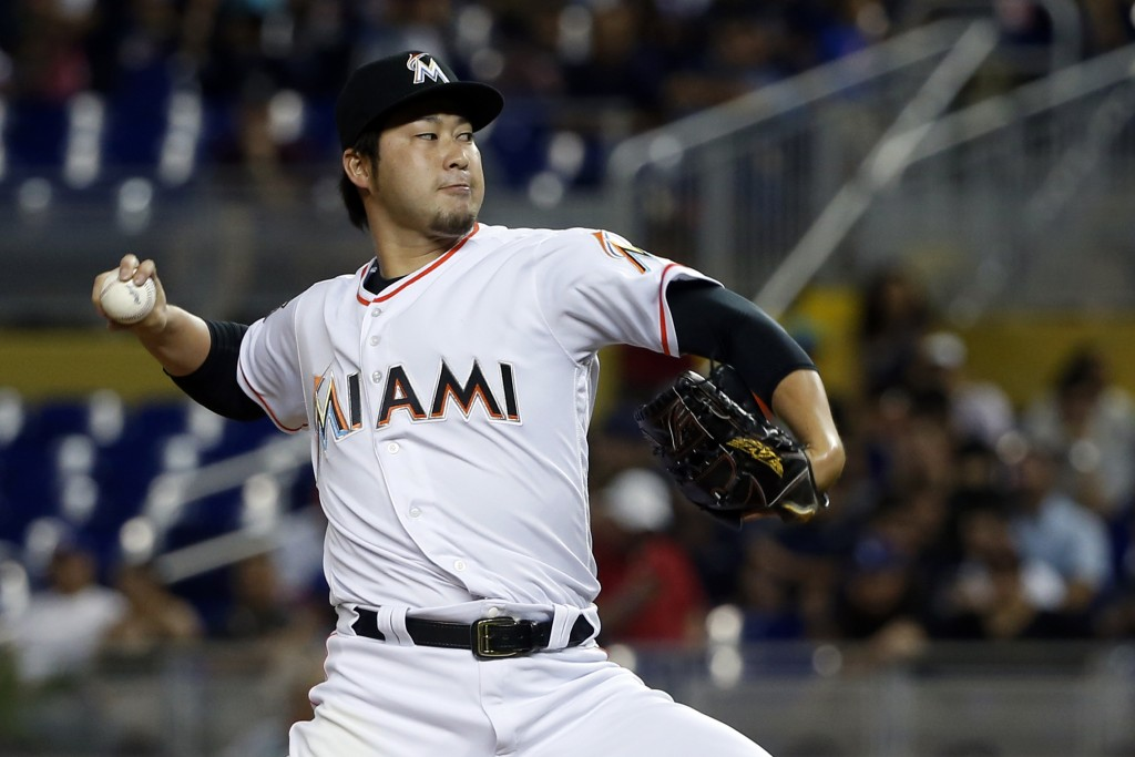 Miami Marlins' Junichi Tazawa, of Japan, delivers a pitch during the fourth inning of a baseball game against the Los Angeles Dodgers, Thursday, May 1