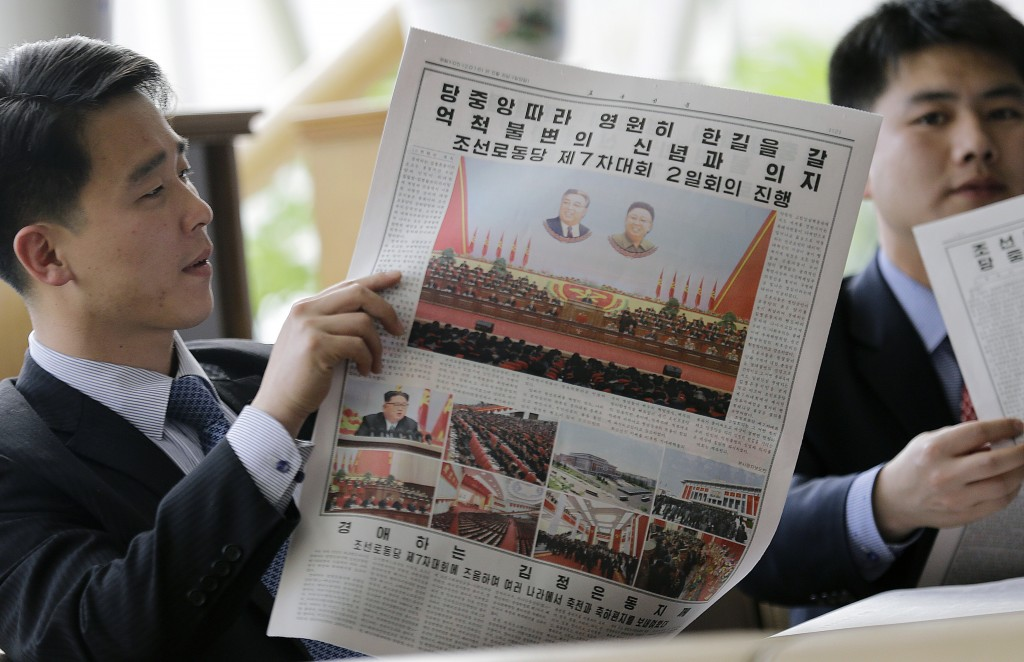 FILE - In this May 8, 2016, file photo, North Koreans read their leader Kim Jong Un's speech published in the local newspaper in Pyongyang, North Kore
