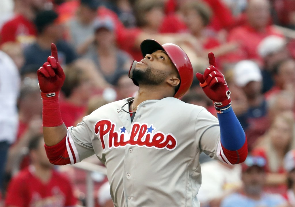 Philadelphia Phillies' Carlos Santana looks skyward as he rounds the bases after hitting a solo home run during the fifth inning of a baseball game ag