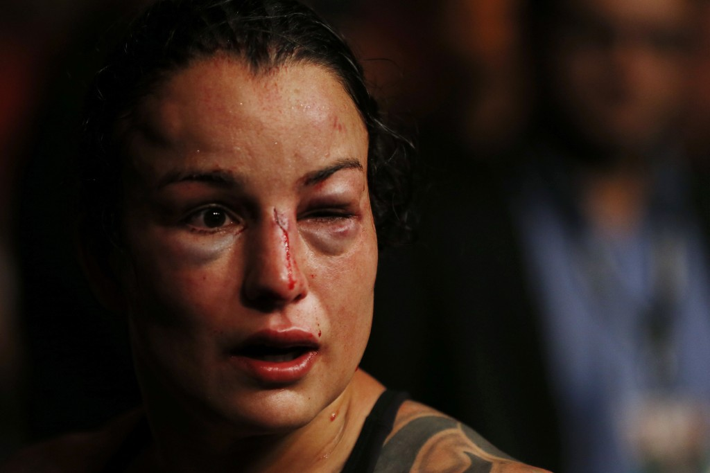 In this early Sunday, May 13, 2018 photo, U.S. competitor Raquel Pennington leaves the octagon after losing the UFC women's bantamweight mixed martial