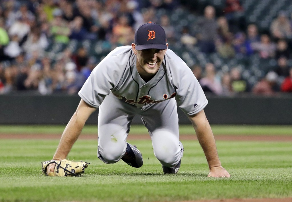 Detroit Tigers starting pitcher Matthew Boyd smiles after crouching to get out of the way of a thrown ball during the fourth inning of the team's base