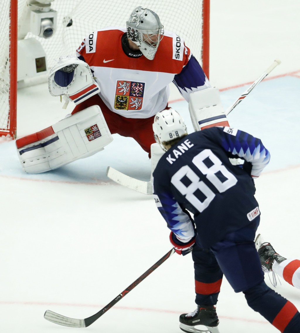 Patrick Kane, right, of the United States shoots to score past Czech Republic's Pavel Francouz, left, during the Ice Hockey World Championships quarte