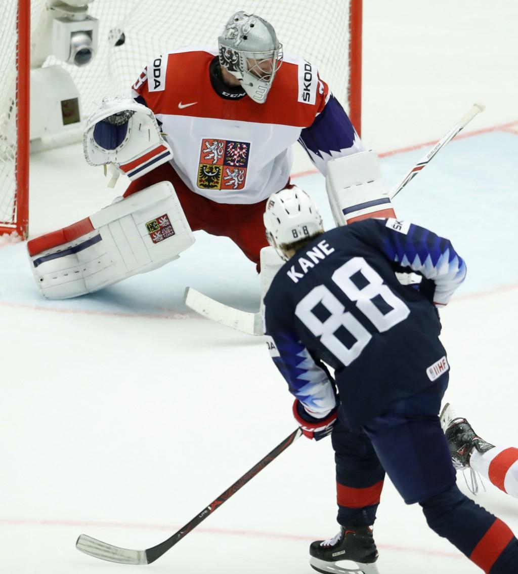 Patrick Kane, right, of the United States shoots to score past Czech Republic's Pavel Francouz, left, during the Ice Hockey World Championships quarte