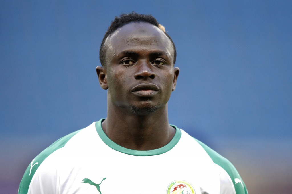 FILE - In this Tuesday, March 27, 2018 file photo, Senegal's Sadio Mane listens to national anthem prior to their friendly soccer match against Bosnia