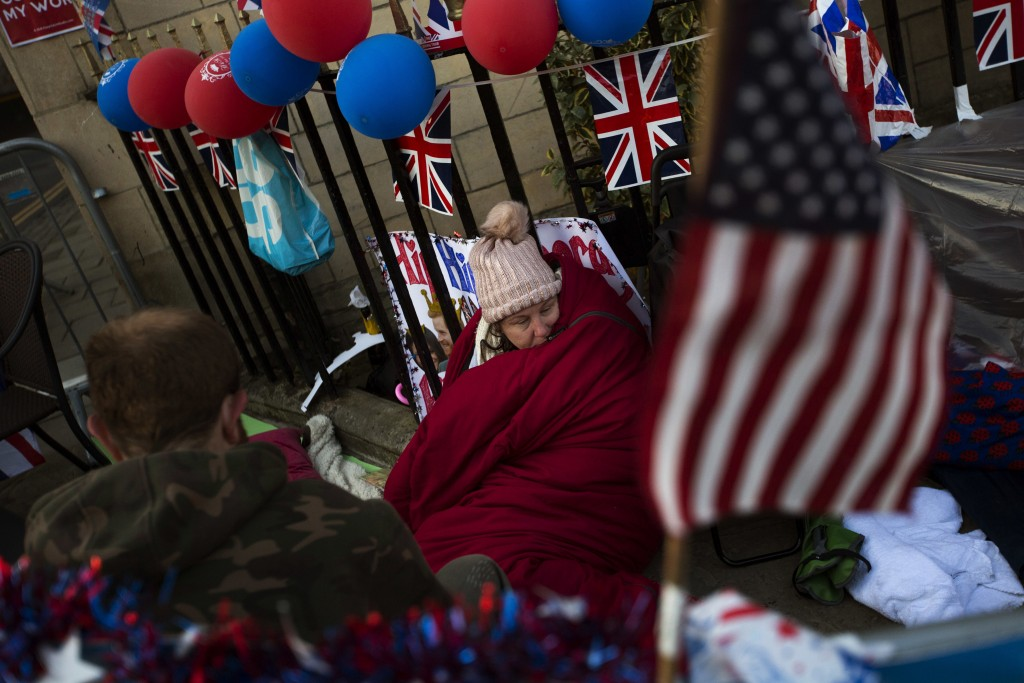 A woman spends the night near Windsor castle, England, Friday, May 18, 2018. Preparations continue in Windsor ahead of the royal wedding of Britain's