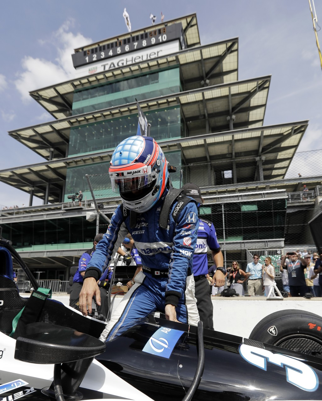 Takuma Sato, of Japan, climbs into his car during a practice session for the IndyCar Indianapolis 500 auto race at Indianapolis Motor Speedway in Indi