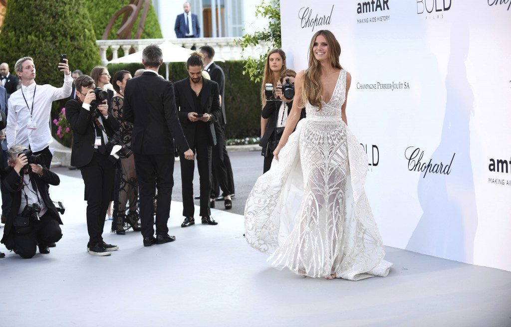 Model Heidi Klum poses for photographers upon arrival at the amfAR, Cinema Against AIDS, benefit at the Hotel du Cap-Eden-Roc, during the 71st interna