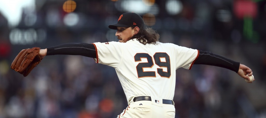 San Francisco Giants pitcher Jeff Samardzija works against the Colorado Rockies during the first inning of a baseball game Thursday, May 17, 2018, in