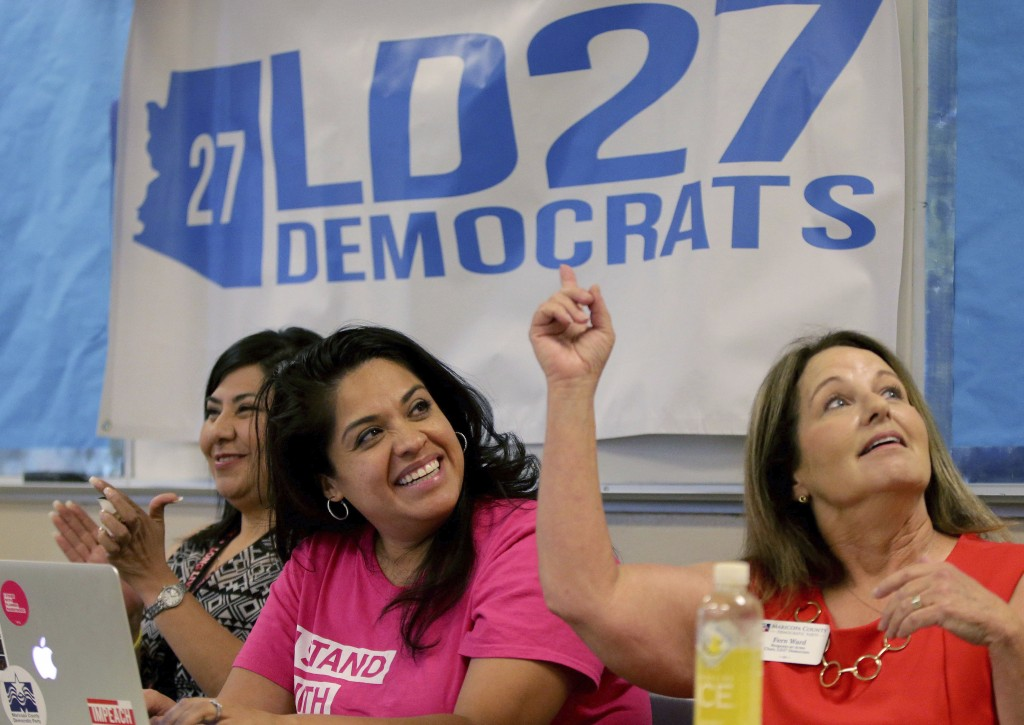 In this Wednesday, May 9, 2018 photo, Arizona Democratic District 27 Chair Fern Ward, right, and Vice Chair Maritza Saenz react to a speaker during th