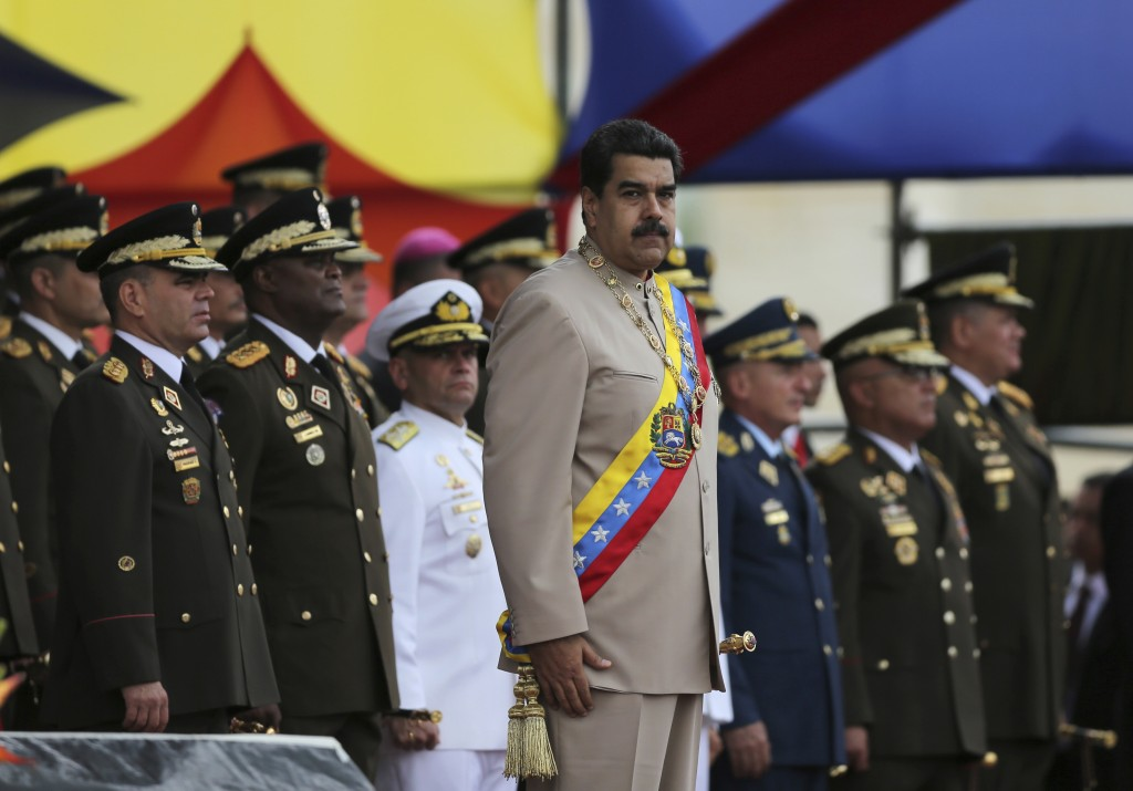 FILE - In this June 24, 2017 file photo, Venezuela's President Nicolas Maduro oversees a military parade on Army Day at Fort Tiuna in Caracas, Venezue