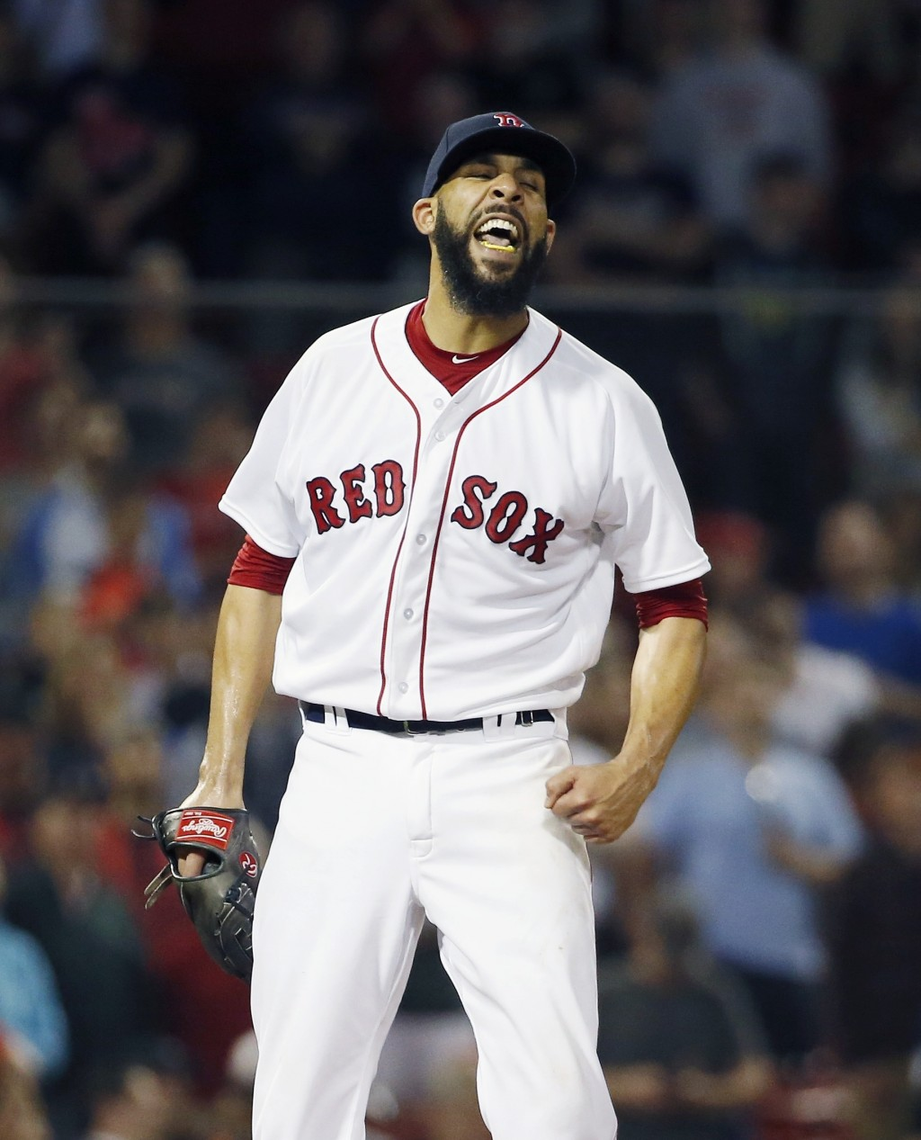 Boston Red Sox's David Price celebrates after Baltimore Orioles' Jonathan Schoop flied out for the final out of a baseball game in Boston, Thursday, M