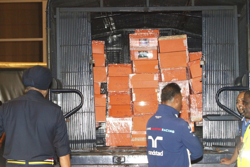 Boxes containing confiscated items are put inside a police truck in Kuala Lumpur, Malaysia Friday, May 18, 2018. Malaysian police confiscated a few hu