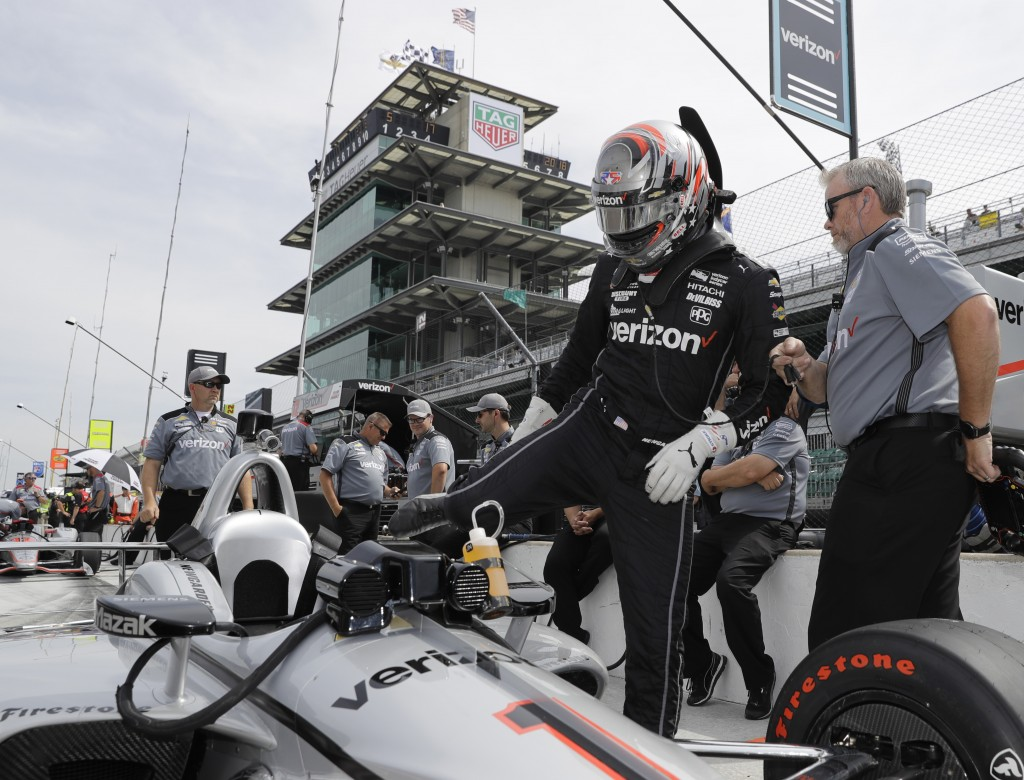 Josef Newgarden climbs into his car during a practice session for the IndyCar Indianapolis 500 auto race at Indianapolis Motor Speedway in Indianapoli