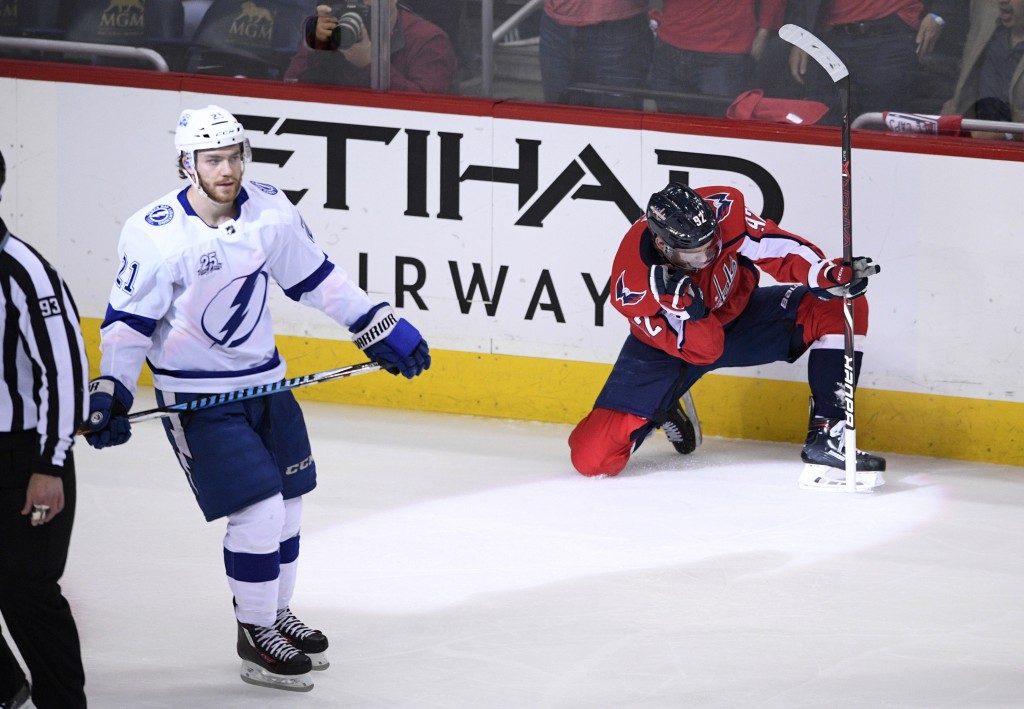 Washington Capitals center Evgeny Kuznetsov (92), of Russia, celebrates his goal as Tampa Bay Lightning center Brayden Point (21) skates by during the