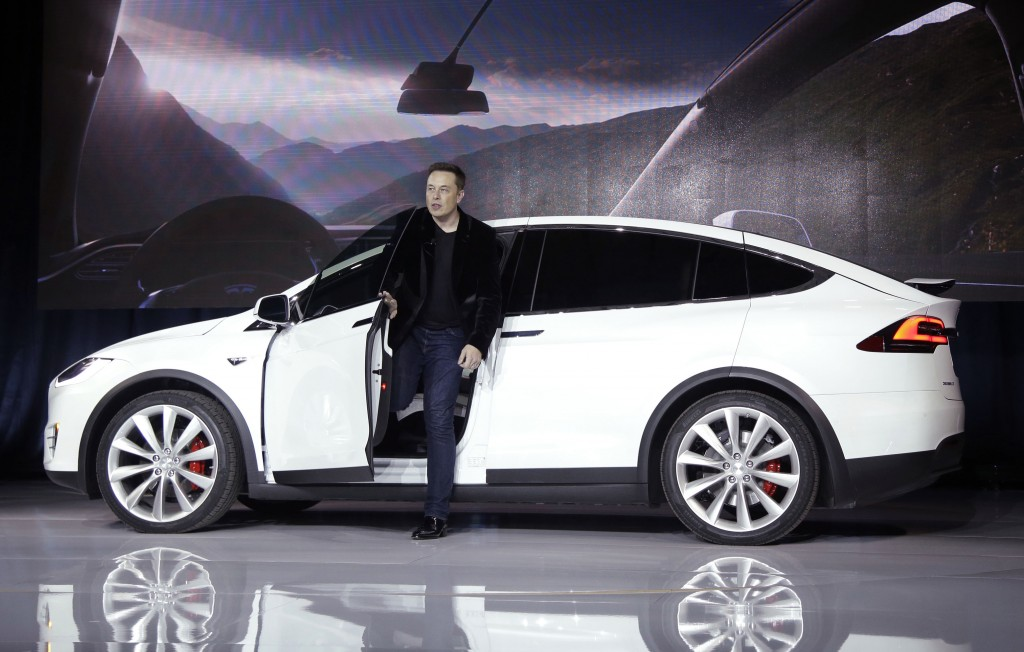FILE - In this Sept. 29, 2015, file photo, Elon Musk, CEO of Tesla Motors Inc., introduces the Model X car at the company's headquarters in Fremont, C