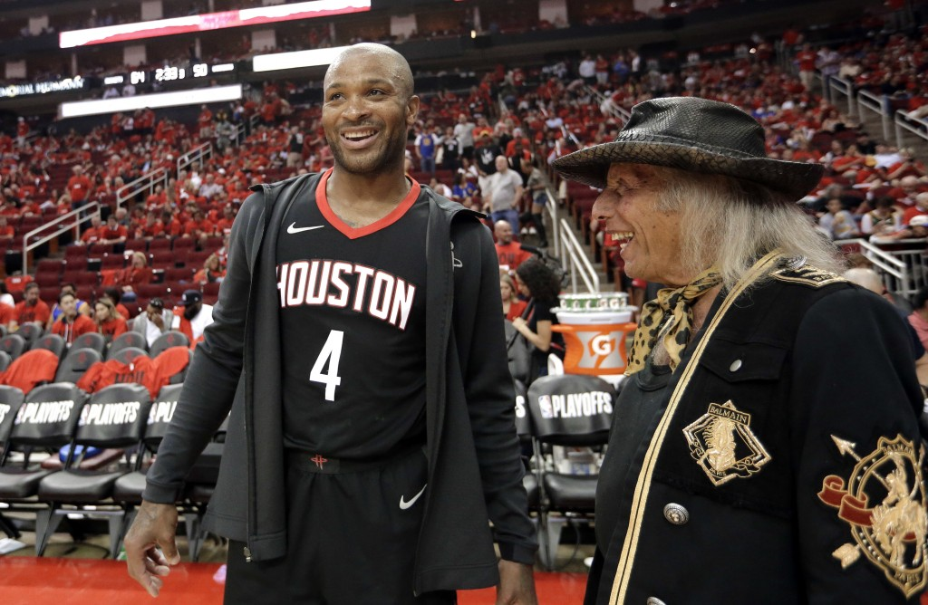 Houston Rockets' P.J. Tucker (4) talks with NBA fan James Goldstein during halftime in Game 2 of the team's NBA basketball Western Conference finals a