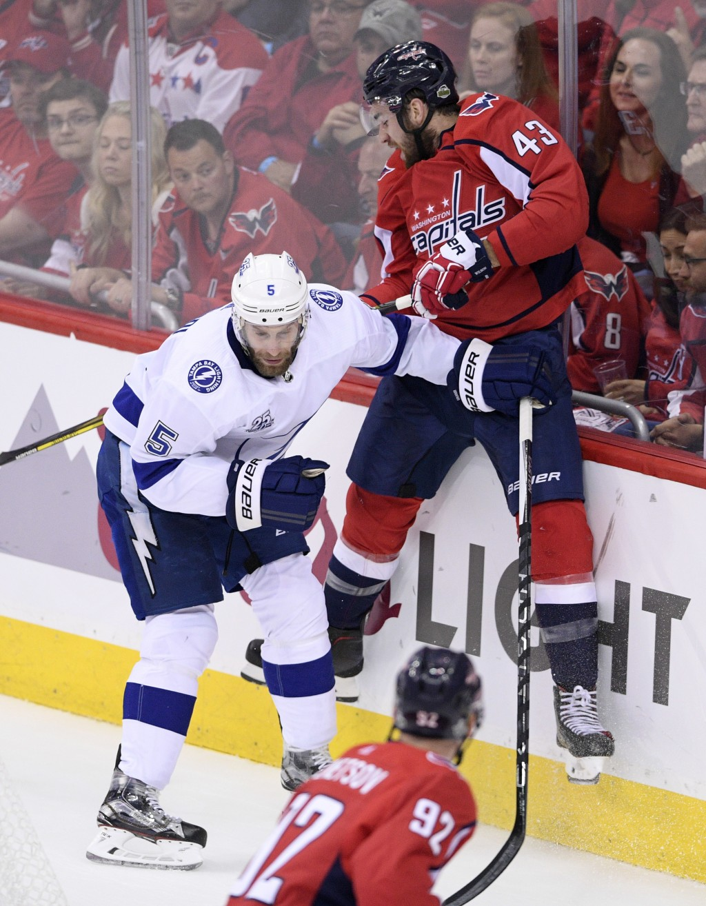 Washington Capitals right wing Tom Wilson (43) hits the boards next to Tampa Bay Lightning defenseman Dan Girardi (5) during the first period of Game