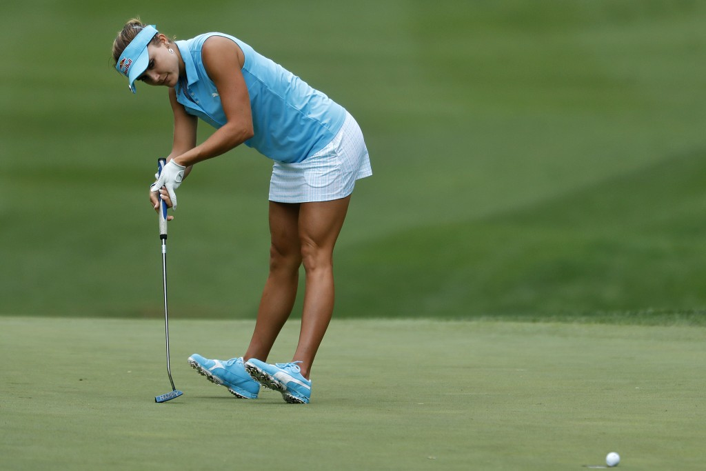 Lexi Thompson reacts after missing a putt on the fourth hole during the first round of the LPGA Tour's Kingsmill Championship golf tournament Thursday