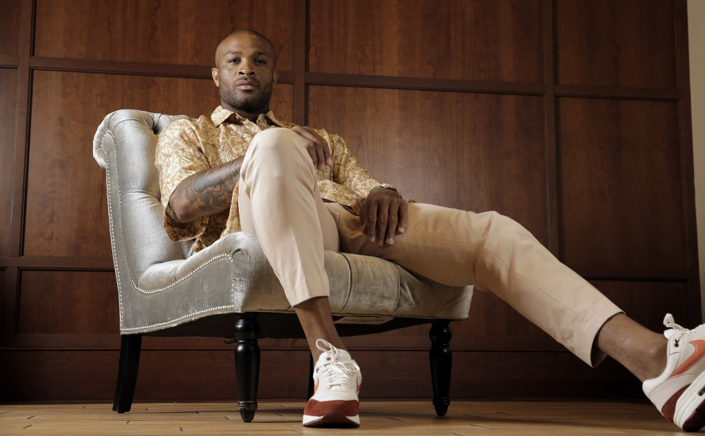 Houston Rockets' P.J. Tucker poses in a shirt and pants from Dries Van Noten with Nike Air Max 1 shoes Tuesday, May 15, 2018, in Houston. Tucker's pla