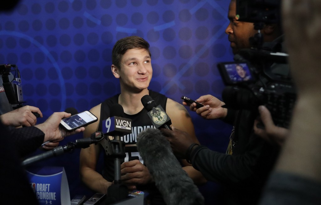 Grayson Allen, from Duke, listens to a question as he speaks with reporters at the NBA draft basketball combine Thursday, May 17, 2018, in Chicago. (A