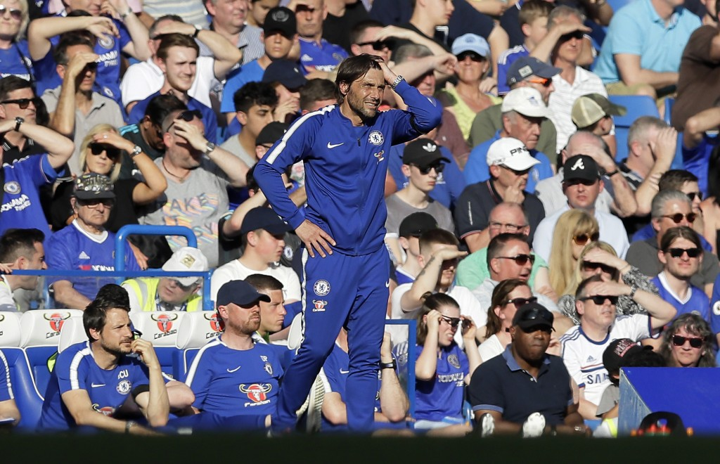 FILE - In this Sunday, May 6, 2018 file photo, Chelsea coach Antonio Conte stands during the English Premier League soccer match between Chelsea and L...
