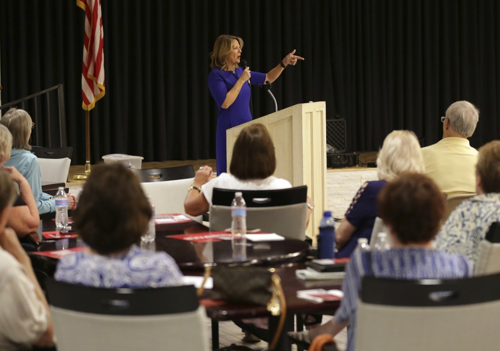 In this Tuesday, May 8, 2018 photo, U.S. Senatorial candidate Kelli Ward speaks to volunteers and voters during the Sun Lakes Republican Club meeting