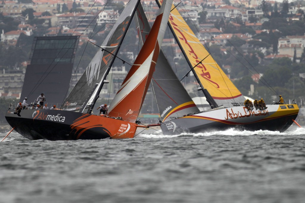 FILE - In this June 7, 2015, file photo, Team Alvimedica, left, crosses Abu Dhabi Ocean Racing as they sail during the Leg 8 course race from Lisbon,