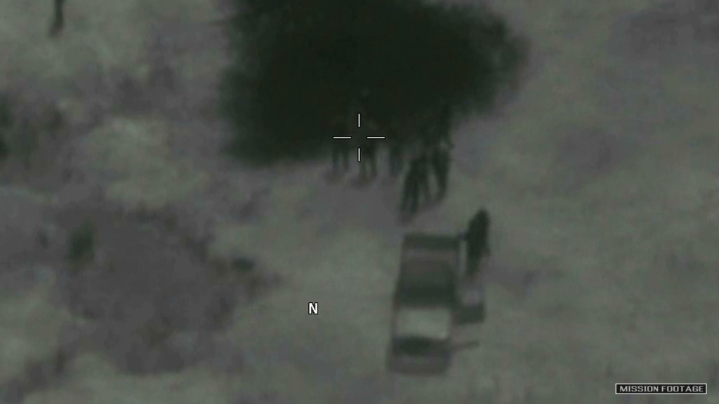 In this image from video released by the Department of Defense, Niger military members arrive at the scene where the body of Army Sgt. La David T. Joh