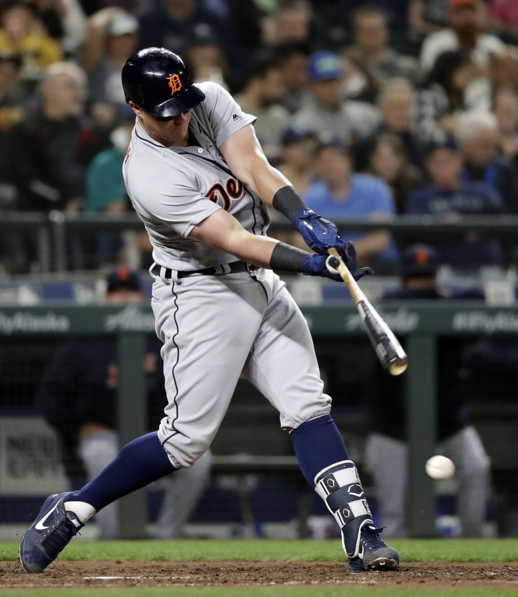 Detroit Tigers' James McCann hits a ground ball against the Seattle Mariners during the sixth inning of a baseball game Thursday, May 17, 2018, in Sea